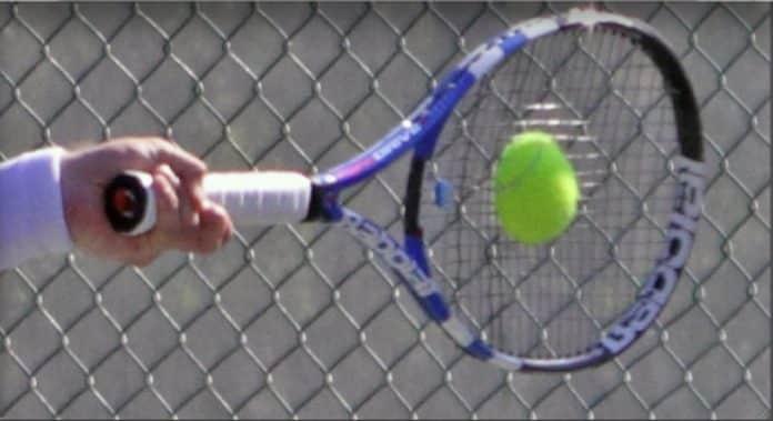 squashing-tennis-ball